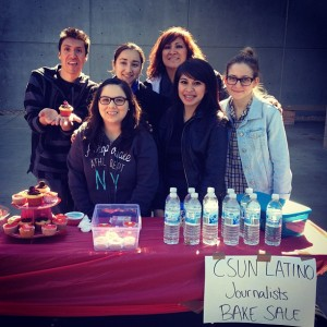 CSUN Latino Journalists selling Valentine's Day themed baked goods. From left to right: Julio Huerta, Claudia Gonzalez, Joana Jacobo, Professor Retis, Cynthia Carrazco, and Karen Guzelian.